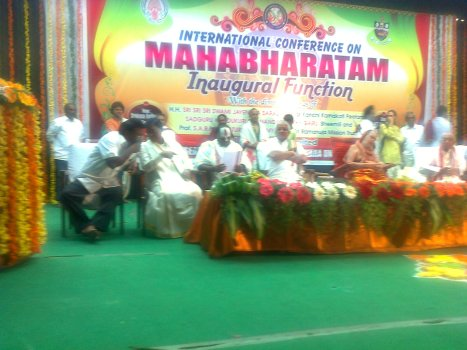 Acharyas and VIPs on the stage during the inauguration