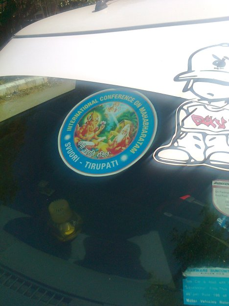 The sticker pasted on the car provoked me and its presence here!